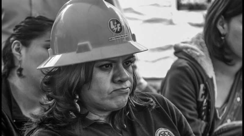 Elva Nora Cruz is the sister of a fired Sindicato Mexicano de Electricistas (SME) member, and sits with Triqui women protesting violence in Oaxaca under a tent in Mexico City's central square, the zocalo (David Bacon)